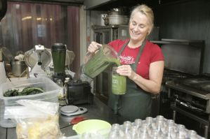Brigitte creating smoothies in a commercial kitchen.
