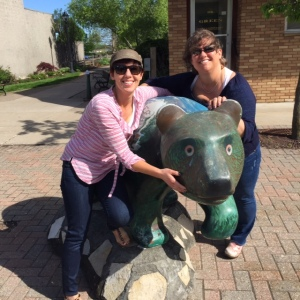 My Sis and I hug wrestling the famous Elk Rapids green bear!